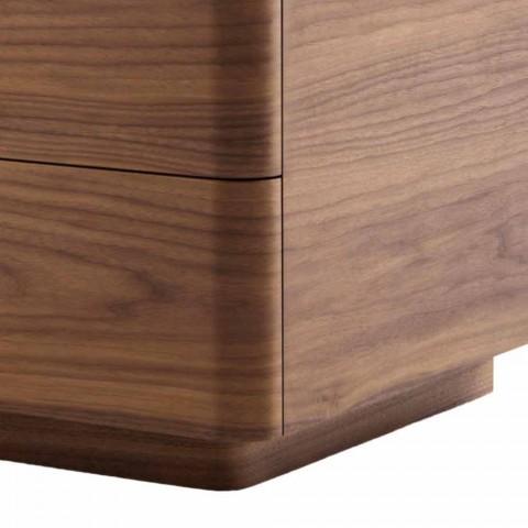 Cómoda de madera maciza y diseño de cuero Grilli York fabricado en Italia.
