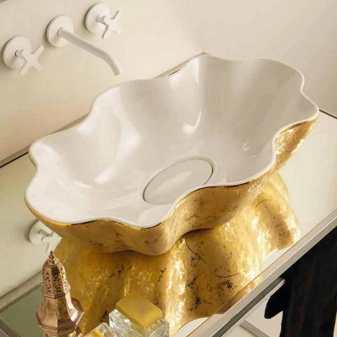 Lavabo sobre encimera de diseño en cerámica blanca y dorada realizado en Italia Cubo