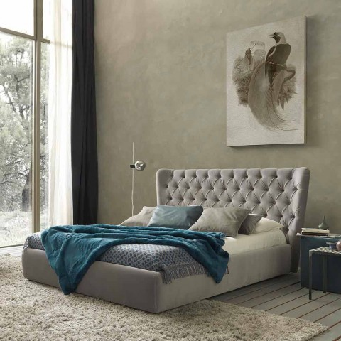 Cama doble con contenedor tapizado en tejido Selene Bolzan.