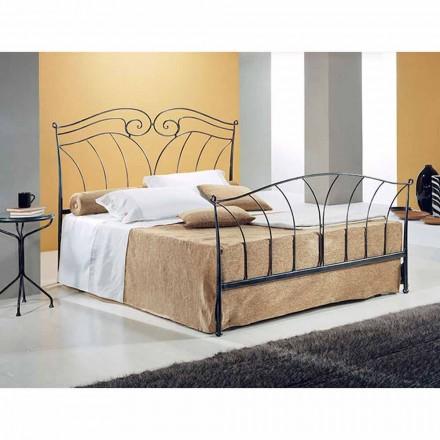 Una cama de plaza y media Hierro forjado Neptuno