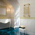 Calentador de toallas eléctrico Scirocco H Amira en latón dorado hecho en Italia